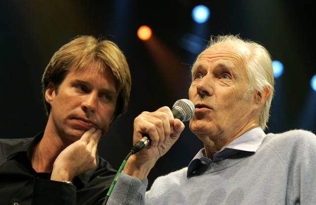 """FILE - In this May 24, 2006 file photo, Giles Martin, left, listens as his father, original Beatles producer George Martin speaks after a sneak preview of a new Beatles-themed Cirque du Soleil show, """"Love,"""" in Las Vegas. Giles Martin has reached into the treasure trove of original recording sessions to remix key albums by John, Paul, George and Ringo. Last year he remixed """"Sgt. Pepper's Lonely Hearts Club Band"""" and returns this year with a fascinating and exhaustive look at """"The Beatles,"""" better known as the """"White Album,"""" which contains such classics as """"Back in the U.S.S.R."""" to """"Blackbird"""" and """"Ob-La-Di, Ob-La-Da."""" It coincides with celebrations for the album's 50th birthday. (AP Photo/Jae C. Hong, File)"""