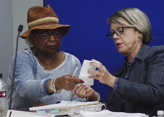 Broward Supervisor of Elections Brenda Snipes, left, and judge Betsy Benson of the election canvassing board, listen to arguments, Sunday, Nov. 11, 2018, at the Broward Supervisor of Elections office in Lauderhill, Fla. (Joe Cavaretta/South Florida Sun-Sentinel via AP)