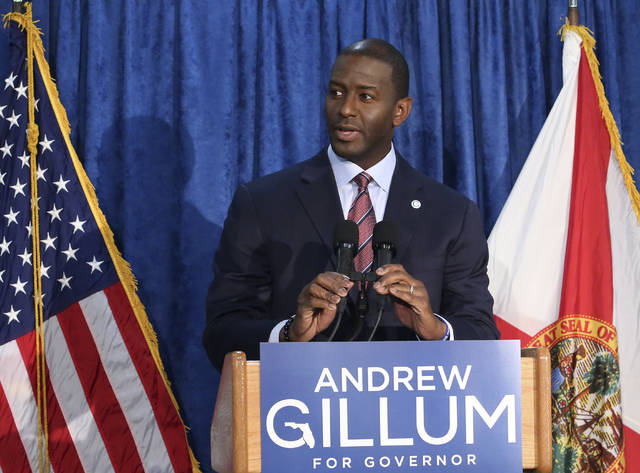 "Andrew Gillum the Democrat candidate for governor speaks at a news conference on Saturday, Nov. 10, 2018, in Tallahassee, Fla.   Gillum has withdrawn his concession in the Florida gubernatorial race following a recount. ""I am replacing my words of concession with an uncompromised and unapologetic call that we count every single vote,"" Gillum said. (AP Photo/Steve Cannon)"