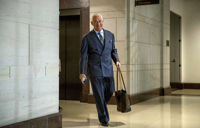FILE - In this Sept. 26, 2017, file photo, longtime Donald Trump associate Roger Stone arrives to testify before the House Intelligence Committee, on Capitol Hill in Washington. An associate of Stone said Monday, Nov. 12, 2018, that he expects to face charges in the special counsel's Russia investigation. Conservative conspiracy theorist Jerome Corsi said on his YouTube show that negotiations fell apart with special counsel Robert Mueller's team and he expects in the coming days to be charged with making false statements. (AP Photo/Andrew Harnik, File)
