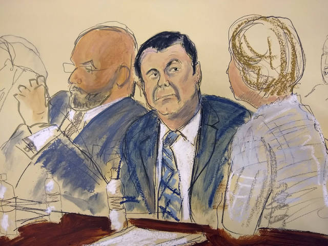 "In this courtroom sketch Joaquin ""El Chapo"" Guzman, center, sits next to his defense attorney Eduardo Balazero, left, for opening statements as Guzman's high-security trial gets underway in the Brooklyn borough of New York, Tuesday, Nov. 13, 2018. Guzman pleaded not guilty to charges that he amassed a multi-billion-dollar fortune smuggling tons of cocaine and other drugs in a vast supply chain that reached New York, New Jersey, Texas and elsewhere north of the border. The infamous Mexican drug lord has been held in solitary confinement since his extradition to the United States early last year. (Elizabeth Williams via AP)"