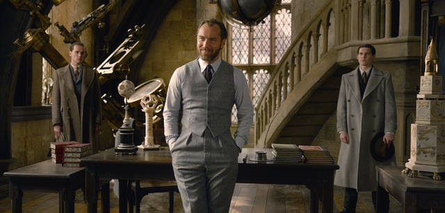 "This image released by Warner Bros. Pictures shows Jude Law in a scene from ""Fantastic Beasts: The Crimes of Grindelwald."" The British actor says he spent an afternoon jotting down notes from author J.K. Rowling who talked to him about Dumbledore's life before becoming the world's most powerful wizard and a fan-favorite in the ""Harry Potter"" series. He will portray the beloved character in ""Fantastic Beasts: The Crimes of Grindelwald,"" which arrives in theaters on Friday. (Warner Bros. Pictures via AP)"