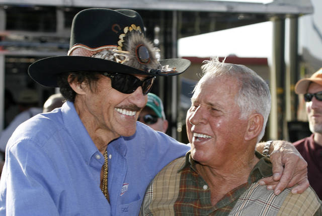FILE - In this Friday, March 6, 2009 file photo, former NASCAR drivers Richard Petty, left, and David Pearson share a laugh during practice for the Kobalt 500 NASCAR Sprint CUp auto race at Atlanta Motor Speedway in Hampton, Ga. NASCAR's Silver Fox David Pearson has died at 83. Pearson was a three-time Cup champion and his 105 career victories trail only Richard Petty's 200 wins on NASCAR's all-time list. (AP Photo/Glenn Smith, File)