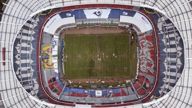 Mexico's Azteca Stadium is seen from above in Mexico City, Tuesday, Nov. 13, 2018. The NFL has moved the Los Angeles Rams' Monday night showdown with the Kansas City Chiefs from Mexico City to Los Angeles due to the poor condition of the field at Azteca Stadium. (AP Photo/Christian Palma)
