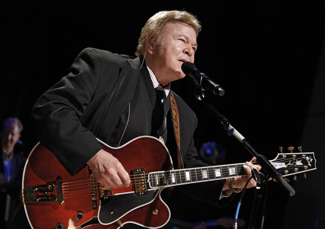 "FILE - In this May 17, 2009, file photo, country music star Roy Clark performs after being inducted into the Country Music Hall of Fame in Nashville, Tenn. Clark, the guitar virtuoso and singer who headlined the cornpone TV show ""Hee Haw"" for nearly a quarter century, died Thursday, Nov. 15, 2018, due to complications from pneumonia at home in Tulsa, Okla., publicist Jeremy Westby said. He was 85.  (AP Photo/Mark Humphrey, File)"