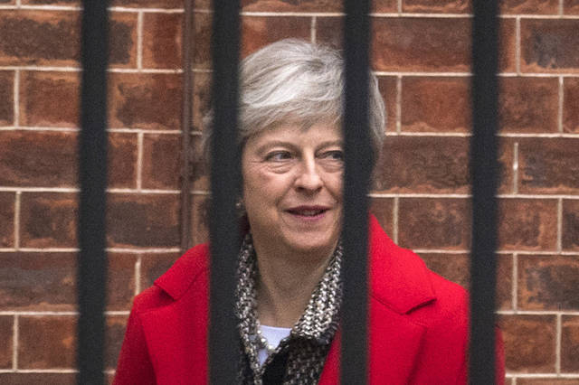 Britain's Prime Minister Theresa May leaves Downing Street in London, Friday, Nov. 16, 2018. May appealed directly to voters to back her Brexit plan Friday as she braced for a potential leadership challenge from rivals within her ruling Conservative Party. (Dominic Lipinski/PA via AP)