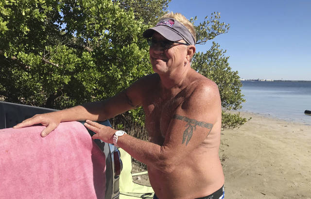 In this Nov. 16, 2018 photo, Mark Toepfer, a 58-year-old from Pinellas Park, reflects on the state's election while at the beach in St. Petersburg, Fla.  Toepfer wondered why the state has so many problems counting ballots this year. (AP Photo/Tamara Lush)