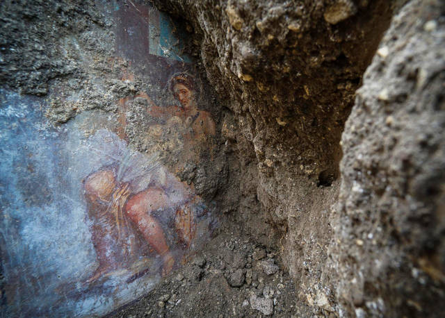 CORRECTS TITLE OF THE FIGURE SHOWN IN THE FRESCO, FROM GODDESS TO QUEEN OF SPARTA - The fresco ''Leda e il cigno'' (Leda and the swan) discovered last Friday in the Regio V archeological area in Pompeii, near Naples, Italy, is seen Monday, Nov. 19, 2018. The fresco depicts a story and art subject of Greek mythology, with Queen of Sparta Leda being impregnated by Zeus -  Jupiter in Roman mythology - in the form of a swan. (Cesare Abbate/ANSA via AP)