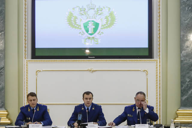 "From left, an aide to the Russian Prosecutor General Mikhail Alexandrov, Russian Prosecutor General spokesman Alexander Kurennoi, and an aide to the Russian Prosecutor General Nikolai Atmoniev attend a news conference in Moscow, Russia, Monday, Nov. 19, 2018. Russian prosecutors on Monday announced new charges against Bill Browder, accusing him of forming a criminal group to embezzle funds in Russia. They also said they suspect Magnitsky's death in prison was a poisoning and said they have a ""theory"" Browder is behind the poisoning. (AP Photo/Pavel Golovkin)"