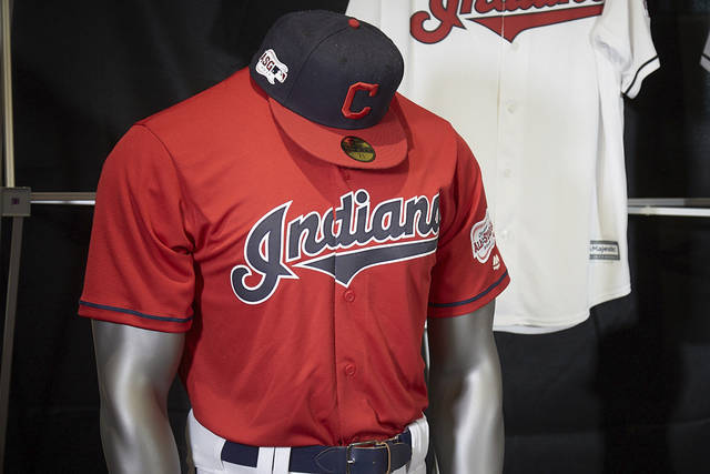 The Cleveland Indians display their 2019 uniforms, including a new home alternate red jersey, Monday morning, Nov. 19, 2018, at the Progressive Field Team Shop in Cleveland, Ohio. (Dan Mendlik/The Cleveland Indians via AP)