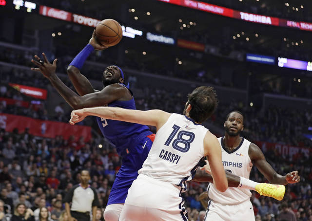 Los Angeles Clippers' Montrezl Harrell, let, shoots over Memphis Grizzlies' Omri Casspi (18) during the second half of an NBA basketball game Friday, Nov. 23, 2018, in Los Angeles. (AP Photo/Marcio Jose Sanchez)