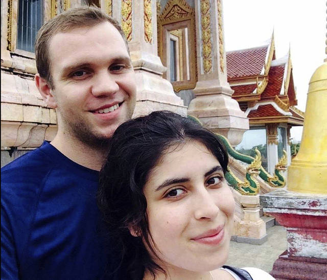 FILE - In this undated family photo, showing Matthew Hedges with his wife Daniela Tejada.  The United Arab Emirates has pardoned British academic researcher Matthew Hedges who was arrested May 5, 2018, at Dubai Airport and subsequently convicted and sentenced to life in prison for alleged espionage. (Daniela Tejada via AP, FILE)