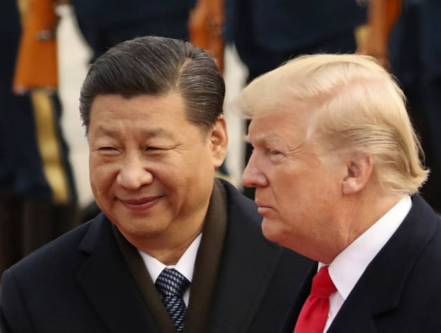 FILE - In this Nov. 9, 2017, file photo, U.S. President Donald Trump and Chinese President Xi Jinping participate in a welcome ceremony at the Great Hall of the People in Beijing, China. Trump is to meet with Xi at the Group of 20 summit in Buenos Aires, Argentina, on Friday, Nov. 30, and Saturday, Dec. 1. (AP Photo/Andrew Harnik, File)