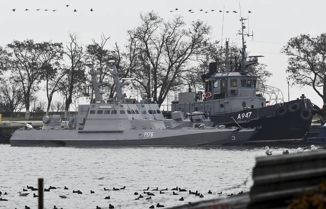 Three Ukrainian ships are seen as they docked after been seized ate Sunday, Nov. 25, 2018, in Kerch, Crimea, Monday, Nov. 26, 2018. The Ukrainian parliament is set to consider a presidential request for the introduction of martial law in Ukraine following an incident in which Russian coast guard ships fired on Ukrainian navy vessels. (AP Photo)
