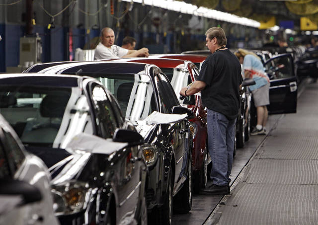 FILE - In this Tuesday, June 15, 2010, file photo, workers at General Motors' Lordstown Assembly plant in Lordstown, Ohio, put the final touches on Chevy Cobalts. One of the last industrial anchors in what was once the heart of manufacturing in Ohio is now on life support after General Motors announced Monday, Nov. 26, 2018, it will stop small-car production at its Lordstown assembly plant and consider closing it for good. (AP Photo/Mark Duncan, File)