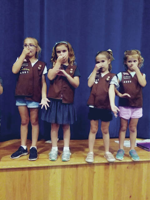 Bridging to Brownies are (left arm of chair, l.-r.) Grace Petor, Stella Reeb, Ava Valenzuela (sibling), (middle of chair, l.-r.) Ella Valenzuela, Alexis Irwin, Hannah Johnson, (right arm, l.-r.) Lanie White, Ava Miller, Claire Anderson, and Macey Large. Not pictured are Avery Smith, Taylor Smith, and Madalyn Jackson.