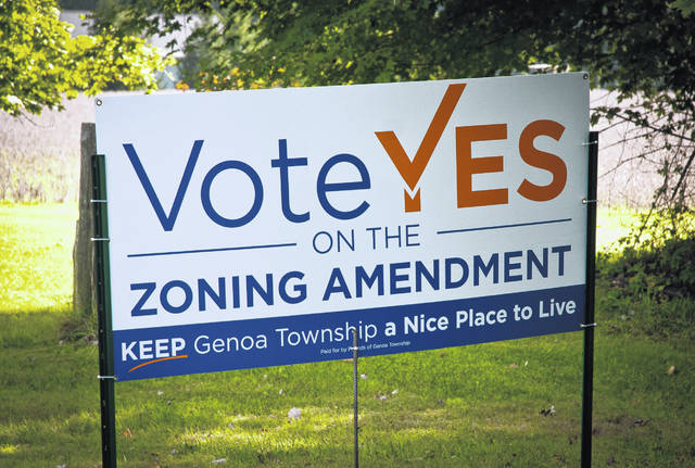 Signs for and against the approval of a referendum that could overturn the Genoa Township Board of Trustees' decision to rezone approximately 43 acres of land from Rural Residential to Planned Residential line the roads of Genoa Township. Voters will decide at the polls Nov. 6.