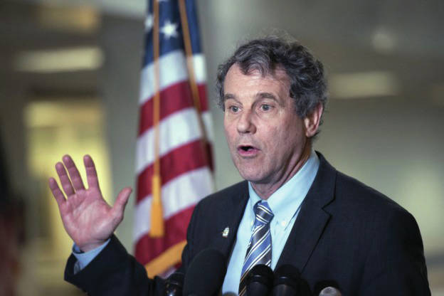 Sen. Sherrod Brown, D-Ohio speaks to members of media after his meeting with Judge Merrick Garland, President Barack Obama's choice to replace Antonin Scalia on the Supreme Court, on Capitol Hill in Washington, Thursday, April 7, 2016. (AP Photo/Sait Serkan Gurbuz)