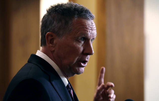 FILE - In this Nov. 15, 2018 file photo, Ohio Gov. John Kasich gestures while addressing reporters in Concord, N.H.   An all-Ohio presidential election in 2020? You would get very long odds in Vegas against that happening. It is possible, though, with two of the state's most popular politicians considering running.  Kasich ran in 2016 and seems ready to try again in 2020. Democratic Sen. Sherrod Brown says he's seriously considering a run.(AP Photo/Charles Krupa)