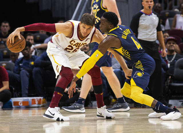 FILE - In this Monday, Oct. 8, 2018, file photo, Cleveland Cavaliers forward Kyle Korver (26) keeps the ball away from Indiana Pacers guard Victor Oladipo (4) during the third quarter of a preseason NBA basketball game, in Cleveland. A person familiar with the deal said Wednesday, Nov. 28, 2018, the Cleveland Cavaliers have agreed to trade veteran forward Korver to the Utah Jazz. (AP Photo/Scott R. Galvin, File)