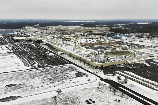 Snow covers the perimeter of the General Motors' Lordstown plant, Wednesday, Nov. 28, 2018, in Warren, Ohio. Even though unemployment is low, the economy is growing and U.S. auto sales are near historic highs, GM is cutting thousands of jobs in a major restructuring aimed at generating cash to spend on innovation. GM put five plants up for possible closure, including the plant in Lordstown. (AP Photo/John Minchillo)