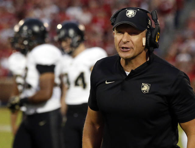 FILE- In this Sept. 22, 2018, file photo, Army head coach Jeff Monken shouts in the first half of an NCAA college football game against Oklahoma in Norman, Okla. For all the complaints about too many bowls, this is the second straight season there will be more bowl eligible teams (at least 81) than available bids (78). That has put No. 23 Army and fellow football independent BYU (6-6), another school with a large national following, in the strange position of tracking results from all over the country in recent weeks and heading into college football's selection Sunday with postseason plans more uncertain than most.  (AP Photo/Sue Ogrocki, File)