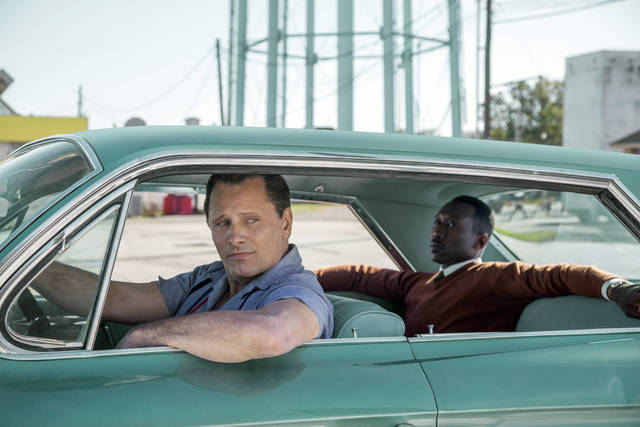 "This image released by Universal Pictures shows Viggo Mortensen, left, and Mahershala Ali in a scene from ""Green Book."" The National Board of Review announced their 2018 honorees, Tuesday, Nov. 27, 2018, with top awards going to ""Green Book"" as best film of the year and best actor of the year going to Mortensen. (Patti Perret/Universal Pictures via AP)"