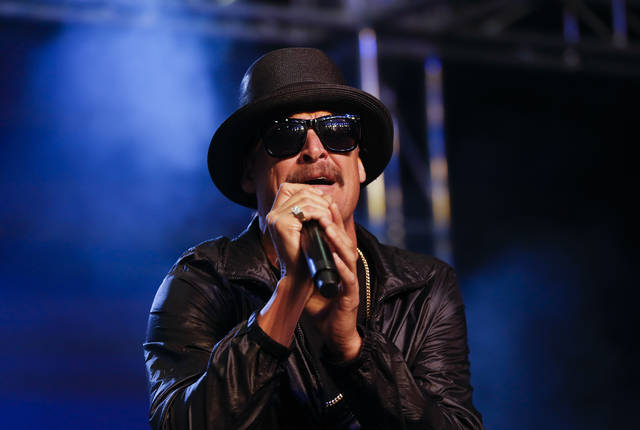 "FILE- In this Oct. 17, 2018, file photo Kid Rock performs during a rally for Republican U.S. Senate candidate John James in Pontiac, Mich. Nashville's mayor might be a no-show at a city Christmas parade if Kid Rock serves as grand marshal. A spokesman for Mayor David Briley says Kid Rock's comments about ""The View"" host Joy Behar were ""hateful"" and that the singer doesn't belong at the head of a parade. (AP Photo/Paul Sancya, File)"