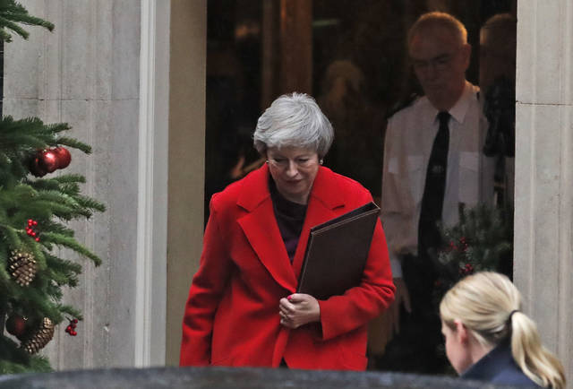 Britain's Prime Minister Theresa May leaves 10 Downing Street to make a statement in Parliament in London, Monday, Dec. 3, 2018. (AP Photo/Frank Augstein)