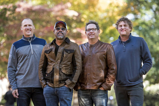 "In this Nov. 16, 2018 photo, Jim Sonefeld, from left, Darius Rucker, Dean Felber, and Mark Bryan, of Hootie & the Blowfish, pose for a portrait at the University of South Carolina in Columbia, S.C. The band is returning with a tour and album 25 years after ""Cracked Rear View"" launched the South Carolina-based rock band. (Photo by Sean Rayford/Invision/AP)"