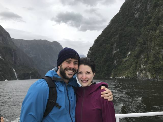 This Feb. 19, 2018 photo provided by Lila Kandel shows Lila and husband Aron while on a tour of Milford sound on the South Island of New Zealand during their honeymoon. Millennials are changing the traditional wedding registry and are forgoing the traditional china and crystal and asking guests to contribute instead to honeymoon adventures, charitable causes and more. (Lila Kandel via AP)