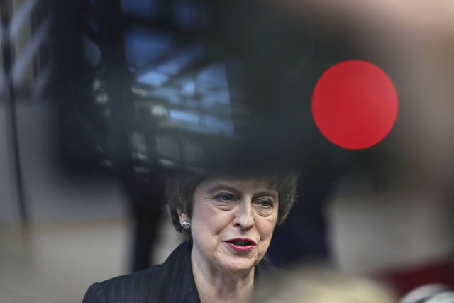 British Prime Minister Theresa May speaks with the media as she arrives for an EU summit in Brussels, Thursday, Dec. 13, 2018. EU leaders gather for a two-day summit, beginning Thursday, which will center on the Brexit negotiations. (AP Photo/Francisco Seco)
