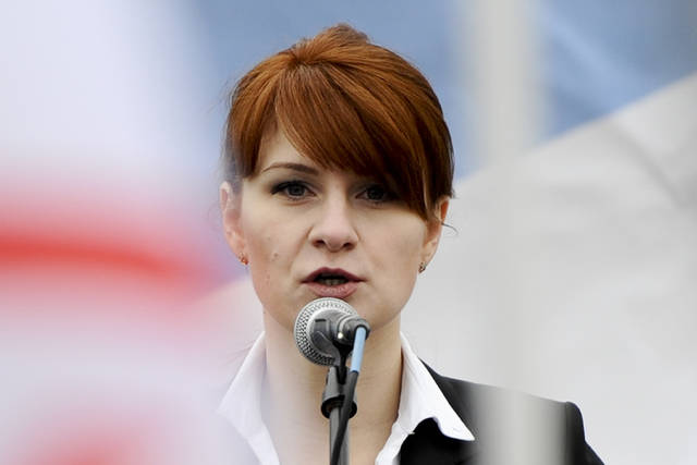 "FILE - In this April 21, 2013 file photo, Maria Butina, leader of a pro-gun organization in Russia, speaks to a crowd during a rally in support of legalizing the possession of handguns in Moscow, Russia. Prosecutors say they have ""resolved"" a case against Butina accused of being a secret agent for the Russian government, a sign that she likely has taken a plea deal. The information was included in a court filing Monday.   (AP Photo/File)"