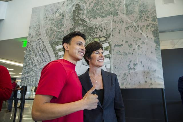 Apple employee Daniel Trevino poses for a photo with Deirdre O'Brien, Apple's Vice President of People, after an announcement about Apple's new campus in Austin, Texas, Thursday, Dec, 13, 2018. Apple plans to build a $1 billion campus in Austin, that will create at least 5,000 jobs ranging from engineers to call-center agents while adding more luster to a Southwestern city that has already become a bustling tech hub. The decision, announced Thursday, comes 11 months after Apple CEO Tim Cook disclosed plans to open a major office outside California on the heels of a massive tax break passed by Congress last year. (Ricardo Brazziell/Austin American-Statesman via AP)