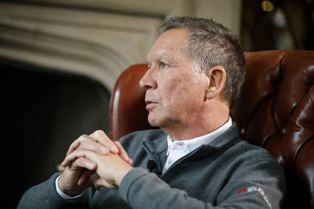 Ohio Gov. John Kasich sits for an interview with The Associated Press at the Ohio Governor's Residence and Heritage Garden, Thursday, Dec. 13, 2018, in Columbus. Kasich discussed his future upon departing office in January, including the possibility of a third presidential run.  (AP Photo/John Minchillo)