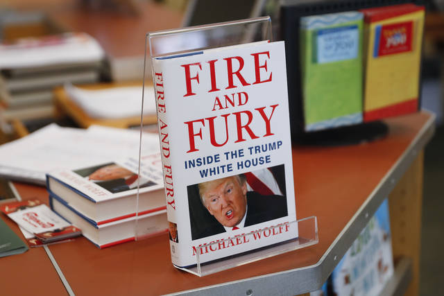 "FILE - This Jan. 5, 2018 file photo shows three remaining copies of the book ""Fire and Fury: Inside the Trump White House,"" by Michael Wolff, displayed at a Barnes & Noble store in Newport, Ky. It landed in early January and quickly had the country talking and President Donald Trump threatening to sue.   (AP Photo/John Minchillo, File)"