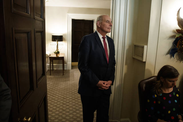 White House Chief of Staff John Kelly listens as President Donald Trump speaks during a meeting with newly elected governors in the Cabinet Room of the White House, Thursday, Dec. 13, 2018, in Washington. (AP Photo/Evan Vucci)