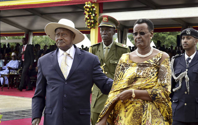 "FILE - In this Thursday, May 12, 2016 file photo, Uganda's long-time president Yoweri Museveni, left, and his wife Janet Museveni, right, attend his inauguration ceremony in the capital Kampala, Uganda. A new movement wants to find out whether President Yoweri Museveni's tentative embrace of a so-called ""national dialogue"", after a government showdown with opposition pop star Bobi Wine, can lead to one of Africa's longest-serving leaders being talked into giving up power. (AP Photo/Stephen Wandera, File)"