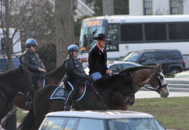 FILE - In this photo provided by the Interior Department shows Interior Secretary Ryan Zinke arriving for his first day of work at the Interior Department in Washington, Thursday, March 2, 2017, aboard Tonto, an 17-year-old Irish sport horse.    Zinke will be leaving the administration at year's end, Trump said Saturday, Dec. 15, 2018.   (Interior Department via AP)