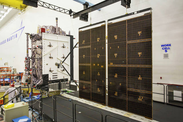 This June 23, 2017 photo provided by Lockheed Martin shows the second GPS III satellite during testing of the deployment of its solar arrays in a clean room at Lockheed Martin's complex south of Denver. The first GPS III satellite is scheduled to be launched from Cape Canaveral, Fla., on Tuesday, Dec. 18, 2018. (Pat Corkery/Lockheed Martin via AP)