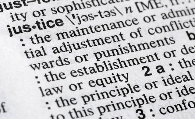 "In this Dec. 12, 2018, photo, ""justice"" is displayed in a Merriam-Webster dictionary in New York. Merriam-Webster has chosen ""justice"" as its 2018 word of the year, driven by the churning news cycle and President Trump's Twitter feed. (AP Photo/Mark Lennihan)"