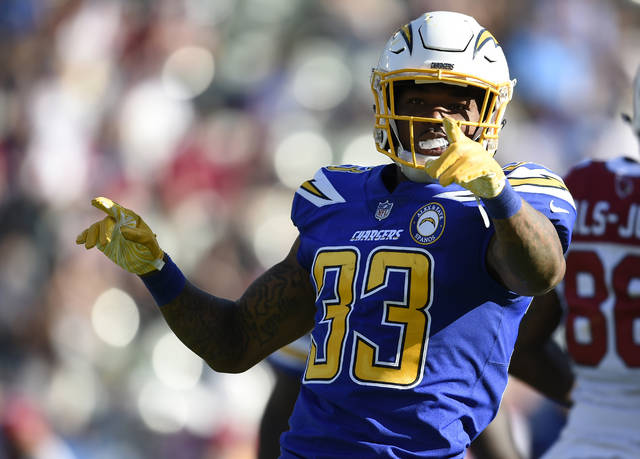 FILE - In this Nov. 25, 2018 file photo Los Angeles Chargers free safety Derwin James (33) gestures after intercepting a pass from Arizona Cardinals quarterback Josh Rosen during the first half of an NFL football game in Carson, Calif. The Los Angeles Chargers placed seven players in the Pro Bowl, including safety Derwin James, one of six rookies across the league to make the game, which will be played Jan. 27 in Orlando. (AP Photo/Kelvin Kuo, file)