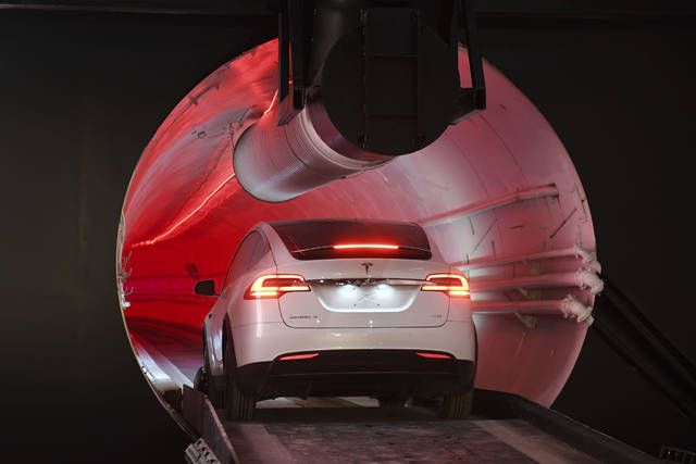 "A modified Tesla Model X drives in the tunnel entrance before an unveiling event for the Boring Co. Hawthorne test tunnel in Hawthorne, Calif., Tuesday, Dec. 18, 2018. Elon Musk unveiled his underground transportation tunnel on Tuesday, allowing reporters and invited guests to take some of the first rides in the revolutionary albeit bumpy subterranean tube - the tech entrepreneur's answer to what he calls ""soul-destroying traffic."" (Robyn Beck/Pool Photo via AP)"