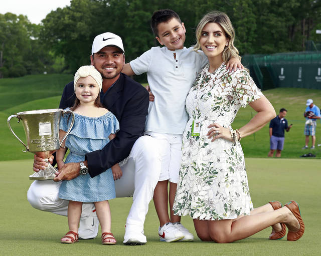 FILE - In this May 6, 2018, file photo, Jason Day poses with, from left to right, his daughter Lucy, son Dash and wife Ellie after winning the Wells Fargo Championship golf tournament at Quail Hollow Club in Charlotte, N.C. Day says he wants to get back to No. 1 and still devote time to his family. (AP Photo/Jason E. Miczek, File)