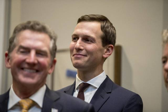 "FILE - In this Nov. 14, 2018, file photo, President Donald Trump's White House senior adviser Jared Kushner, right, smiles as former Sen. Jim DeMint of the Heritage Foundation, left, applauds as President Donald Trump recognizes Kushner as he speaks about H. R. 5682, the ""First Step Act"" in the Roosevelt Room of the White House in Washington, which would reform America's criminal justice system. Kushner is being credited for helping to spearhead what could be the first major bipartisan legislative success of the Trump era: a first-in-a-generation criminal justice reform bill that is expected to pass as soon as this week. (AP Photo/Andrew Harnik, File)"