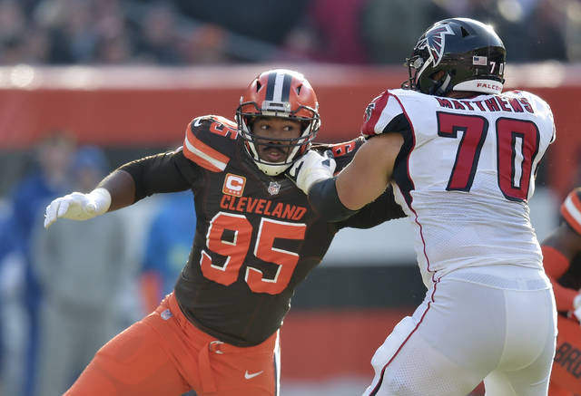 FILE - In this Nov. 11, 2018, file photo, Cleveland Browns defensive end Myles Garrett (95) rushes against Atlanta Falcons offensive tackle Jake Matthews (70) in the second half of an NFL football game in Cleveland.  The former No. 1 overall pick earned his first Pro Bowl selection on Tuesday, Dec. 18, 2018, a personal accomplishment the dominating defensive end said is merely the initial stage of his journey to greatness. (AP Photo/David Richard, File)