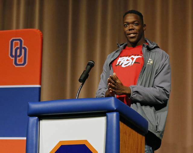 Olentangy Orange's Zach Harrison announces that he will sign with Ohio State over Michigan and Penn State in front of family, friends and students at Olentangy Orange High School, Wednesday, Dec. 19, 2018 in Lewis Center, Ohio. (Kyle Robertson/The Columbus Dispatch via AP)