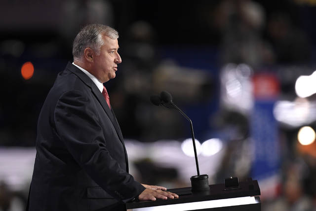 FILE - In this July 18, 2016 file photo, former Speaker of the Ohio House Larry Householder speaks during the opening day of the Republican National Convention in Cleveland.  The state watchdog is alleging widespread fraud within the Ohio agency that provides prison jobs for inmates, including furniture building and vehicle repair. A report released Thursday, Dec. 20, 2018,  by Inspector General Randall Meyer accuses top employees of Ohio Penal Industries of using their positions for personal gain, such as discounts on personal car repairs by inmates. The IG report says Householder was provided an office table and chair set at no cost.  (AP Photo/Mark J. Terrill)