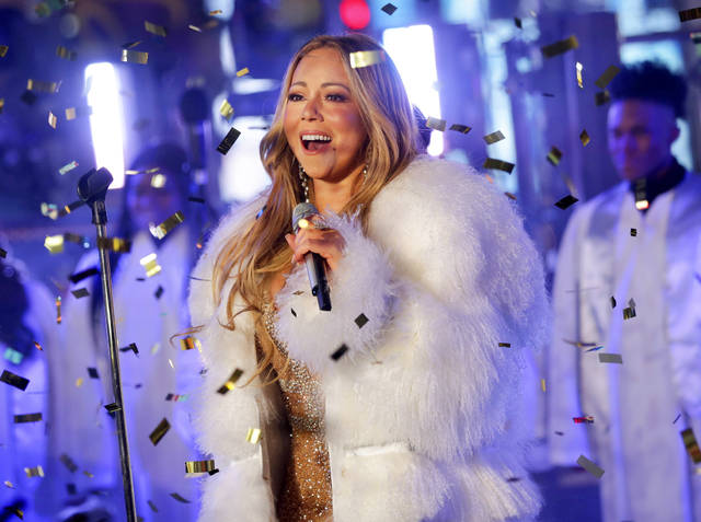 "FILE - In this Dec. 31, 2017 file photo, Mariah Carey performs at the New Year's Eve celebration in Times Square in New York. A poll shows more Americans are favoring Christmas carols over recent Billboard hits, while longtime classics and recent comedies are the most preferred to watch during the holiday season. A poll by The Associated Press-NORC Center for Public Affairs Research shows ""Silent Night"" as the country's most popular, despite Mariah Carey's ""All I Want for Christmas Is You"" becoming the highest-charting Billboard Hot 100 holiday hit in 60 years. (Photo by Brent N. Clarke/Invision/AP, File)"