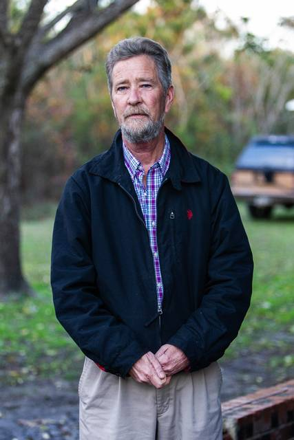 FILE - In this Dec. 5, 2018 photo, Leslie McCrae Dowless poses for a portrait outside of his home in Bladenboro, N. C. N.C. Board of Elections Executive Director Kim Strach warned in a January 2017 letter obtained by The Associated Press that those involved in illegally harvesting absentee ballots in rural Bladen County would likely do it again if they weren't prosecuted. (Travis Long/The News & Observer via AP)